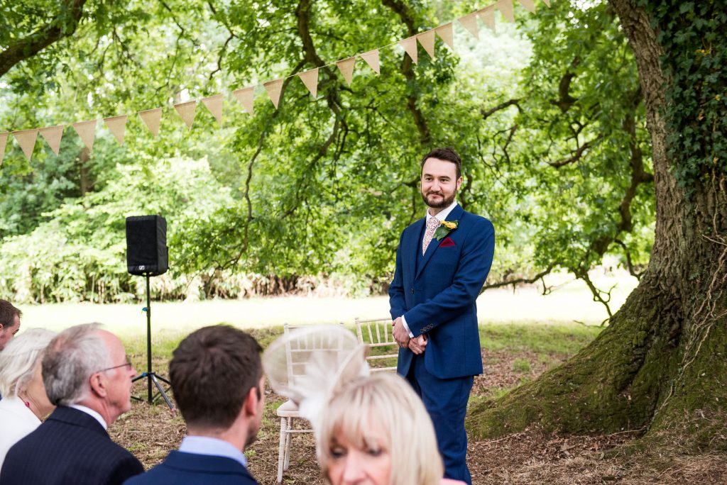 Outdoor Wedding Ceremony, Surrey Wedding Photography, Groom Waits Patiently For His Bride
