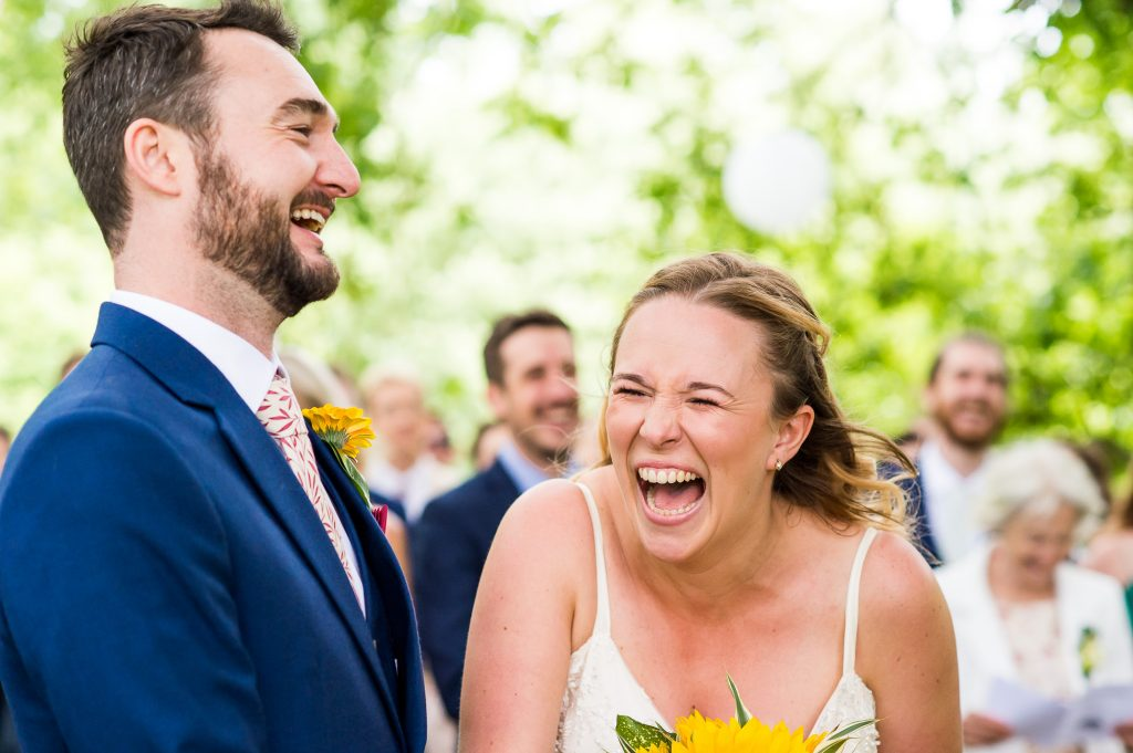 Outdoor Wedding Ceremony, Surrey Wedding Photography, Gorgeous Catherine Deane Bride Laughing During Vows