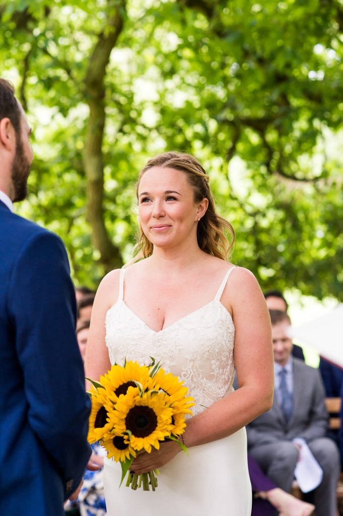 Outdoor Wedding Ceremony, Surrey Wedding Photography, Gorgeous Catherine Deane Bride with Sunflower Bouquet During The Wedding Ceremony