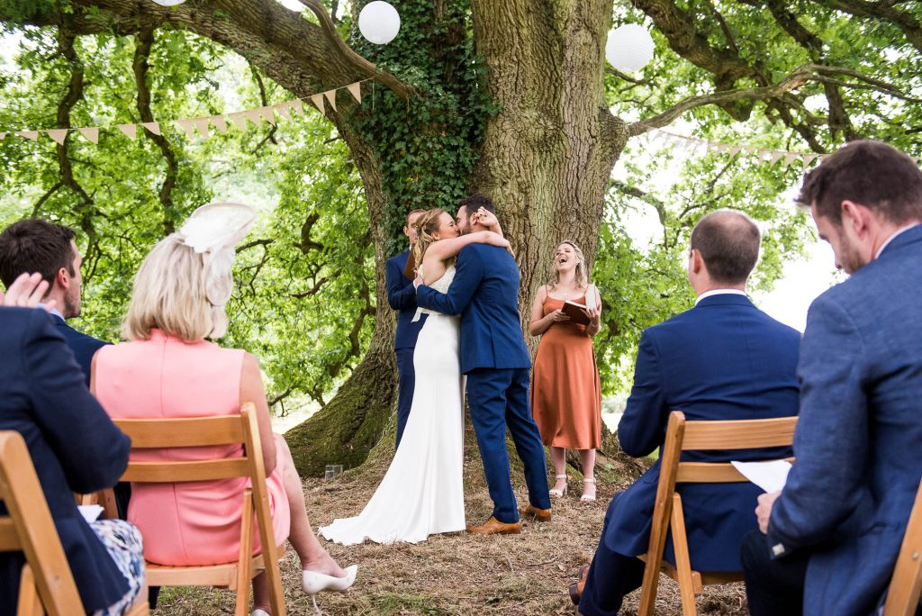 Outdoor Wedding Ceremony, Surrey Wedding Photography, Gorgeous Catherine Deane Bride and Groom Share First Kiss