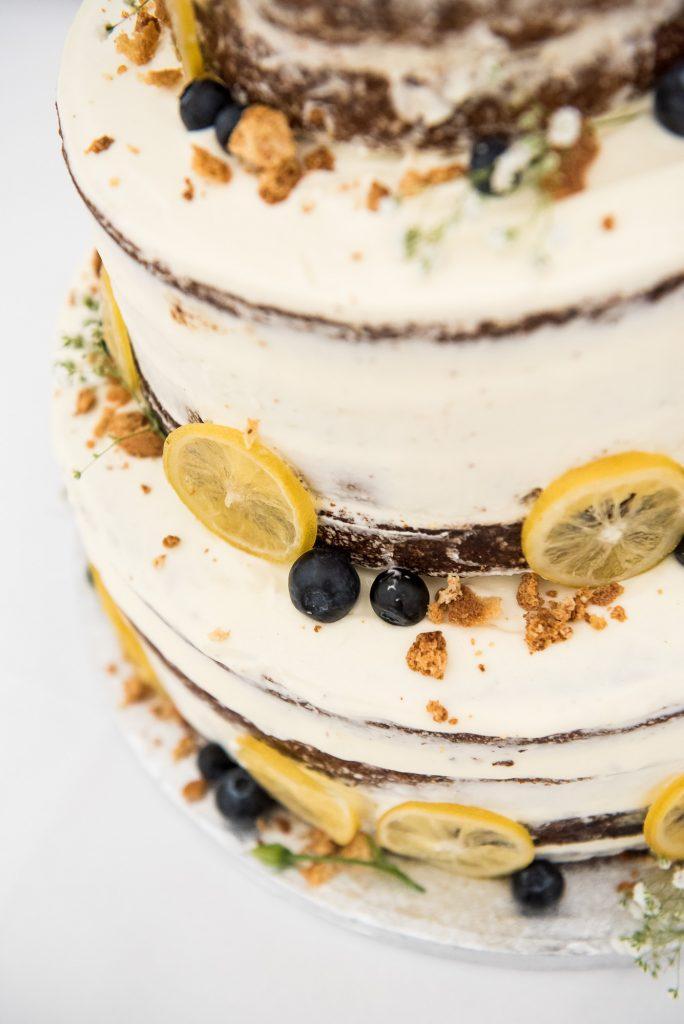 Home made lemon wedding cake with fruit decoration