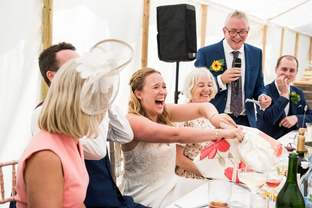 Bride in Hysterics As She Opens Her Wedding Present
