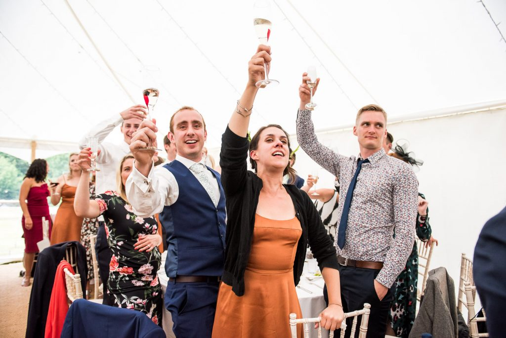 Guest Cheers During Wedding Speeches