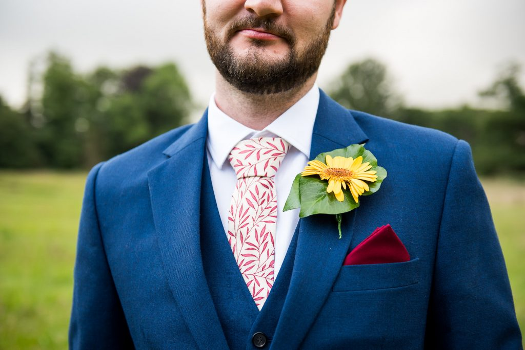 Handsome Groom In Three Piece Navy Blue Suit With Yellow Flower Button Hole
