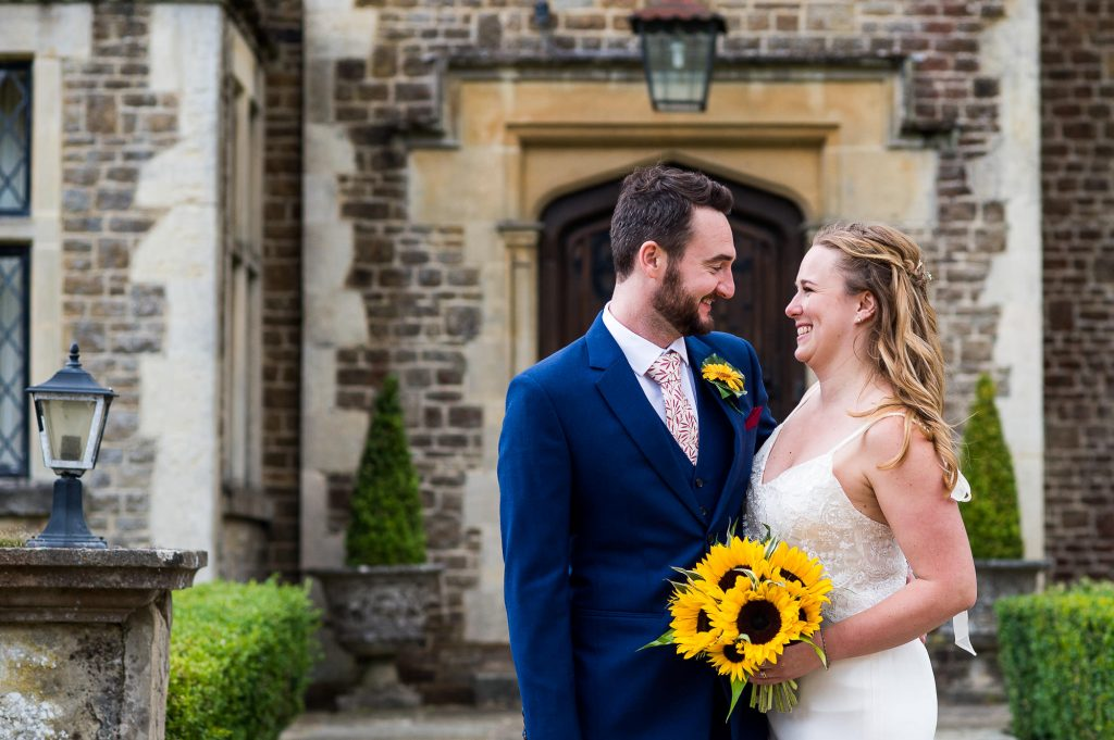 Gorgeous Catherine Deane Bride and Groom Smile At Each Other Lovingly