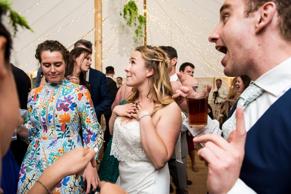 Bride Enjoying Herself On The Dance Floor