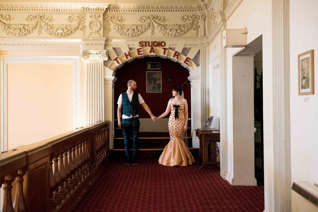 Alternative bride and groom in a theatre