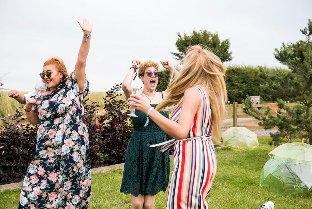 LGBT wedding photography, wedding guests enjoying games and laughing