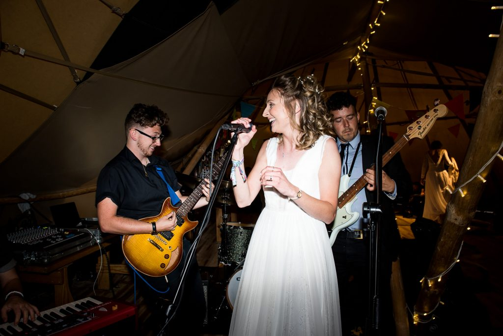 LGBT wedding photography, bride sings live with the wedding band