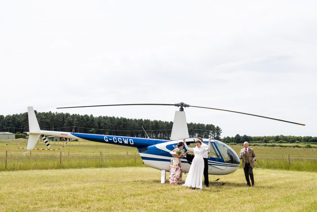 Alternative wedding photography - bride arrives in helicopter at Inkersall Grange Farm