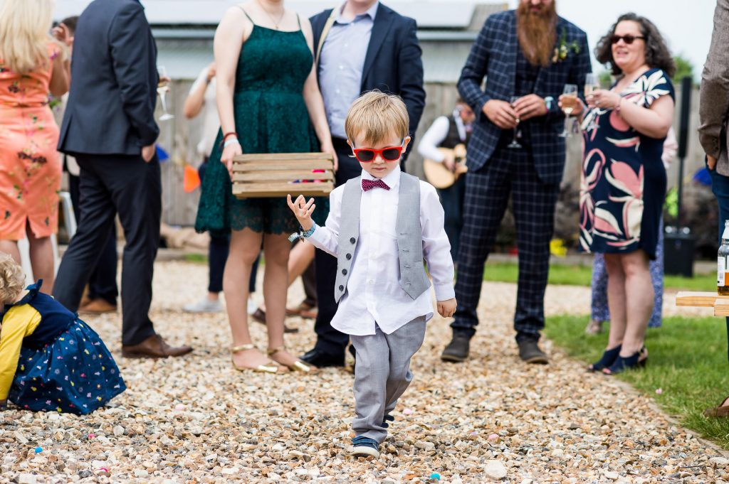 LGBT wedding photography, child in waist coat at festival themed wedding