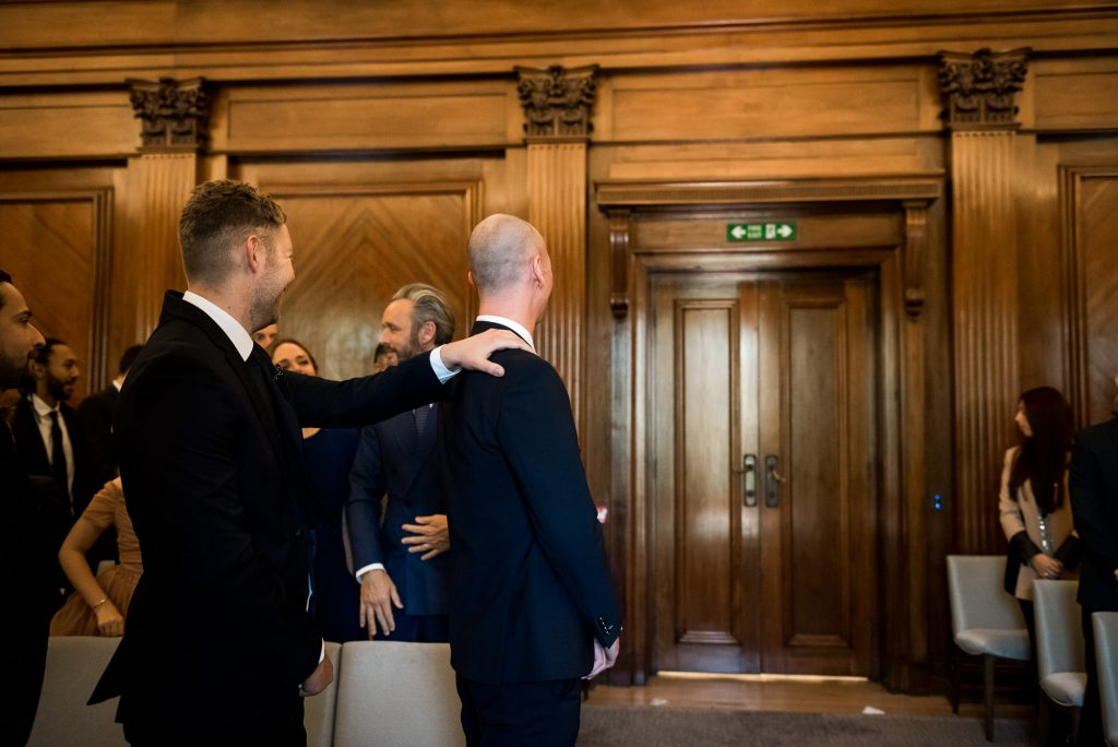 LGBT wedding photography, groom waits for his bride to enter