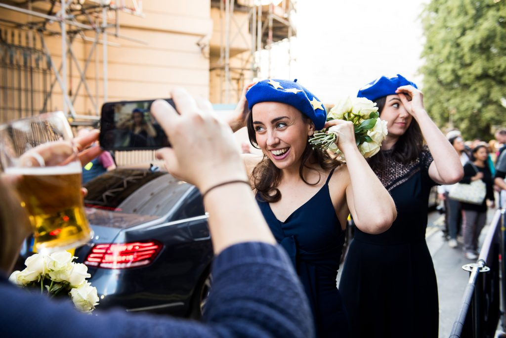 LGBT wedding photography, bridesmaids put on euro berets in anti-brexit march