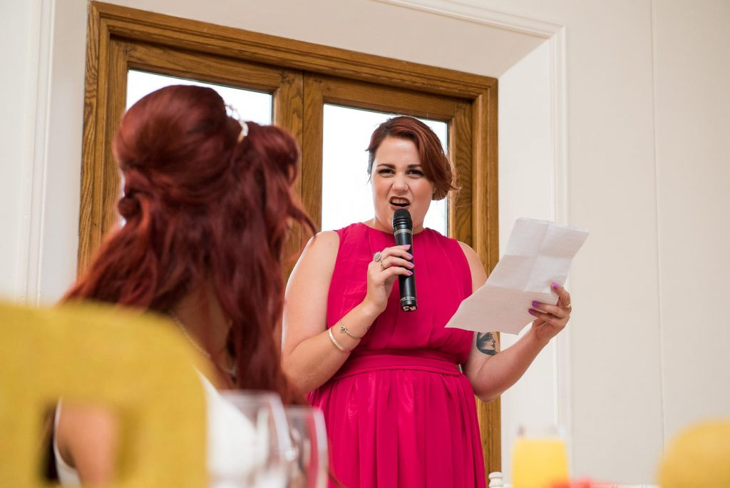 Beautiful maid of honour giving a wedding speech © Jessica Grace Photography