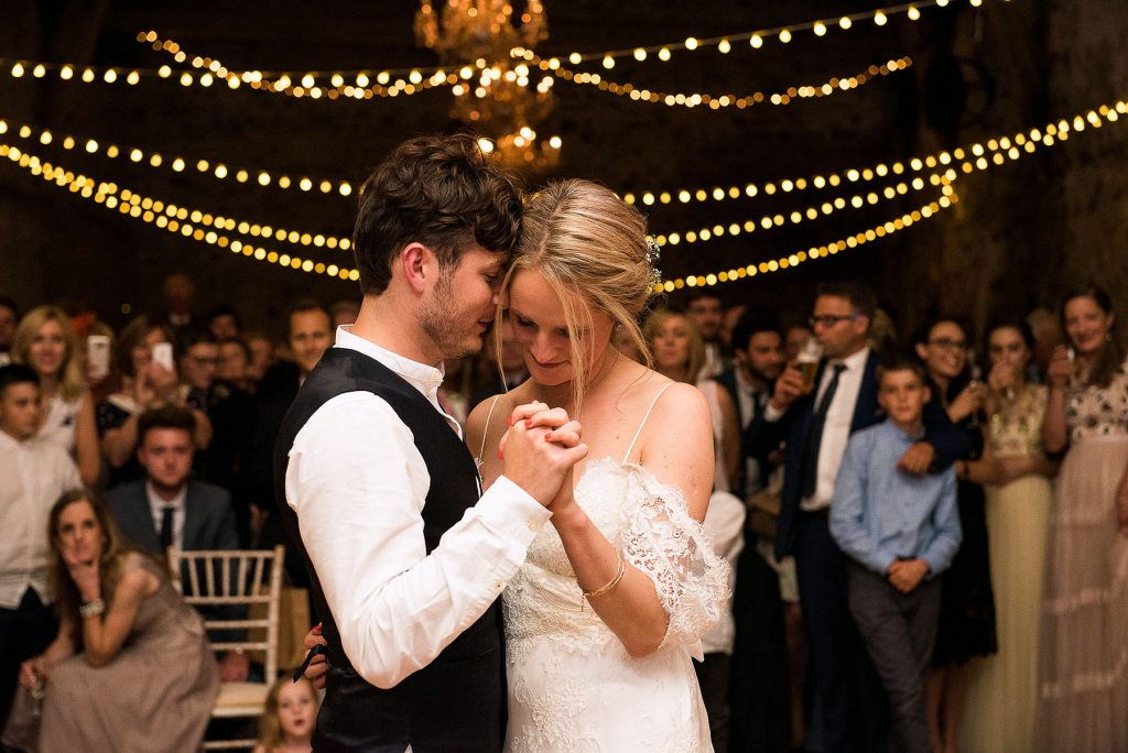 Bride and groom embracing for a first dance