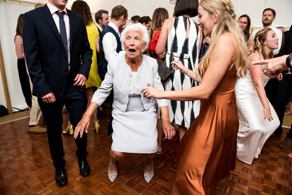 LGBT wedding photography, family dancing on the dance floor with grandmother