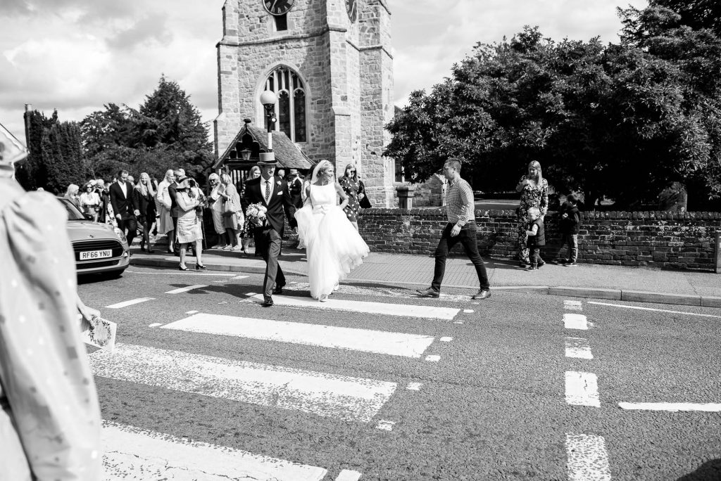 LGBT wedding photography, bride and groom walk to their reception