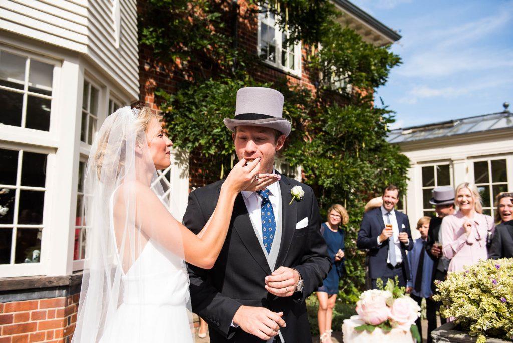 LGBT wedding photography, elegant scandinavian bride feeds groom wedding cake