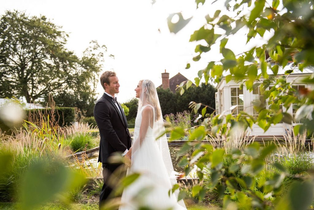 LGBT wedding photography, elegant bride and groom smile in the golden hour sun