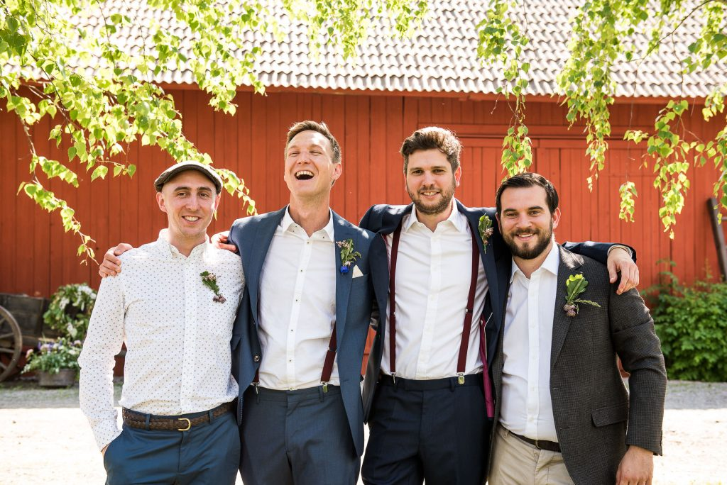 LGBT wedding photography, relaxed group wedding photography with groomsmen in matching braces