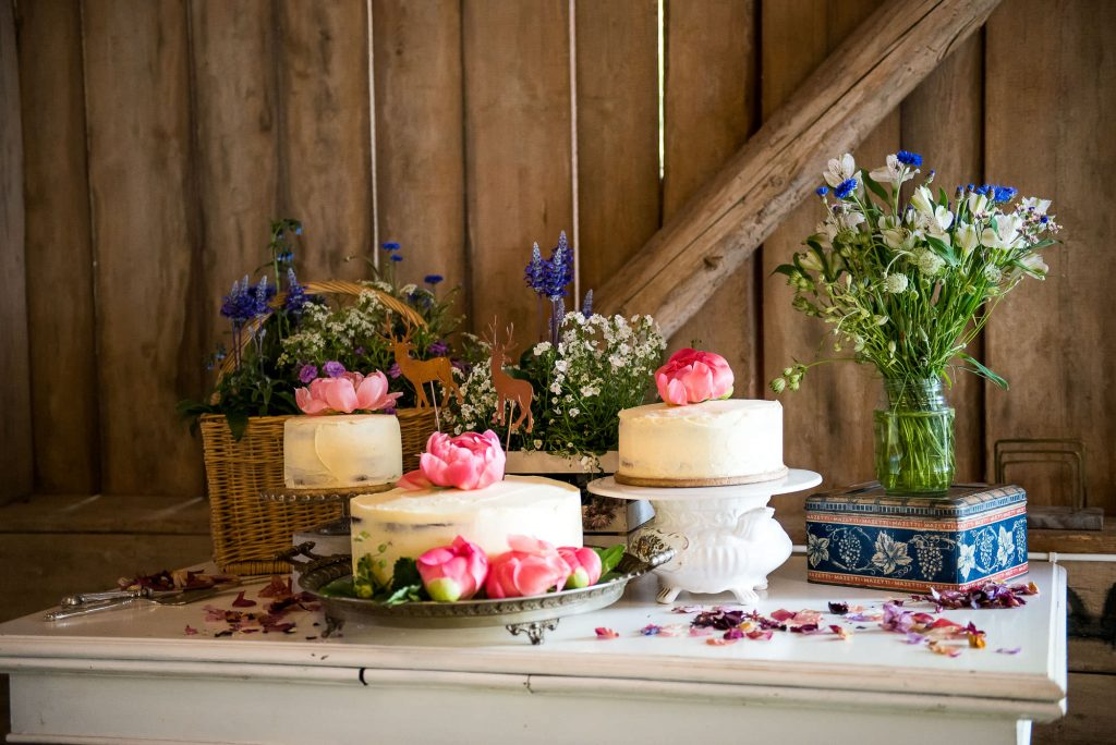 LGBT wedding photography, home made wedding cakes decorated with pink peony flowers