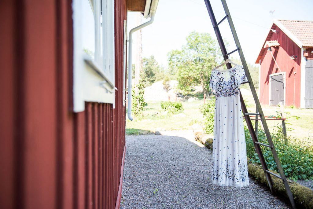LGBT wedding photography, destination wedding photography with wedding dress hanging