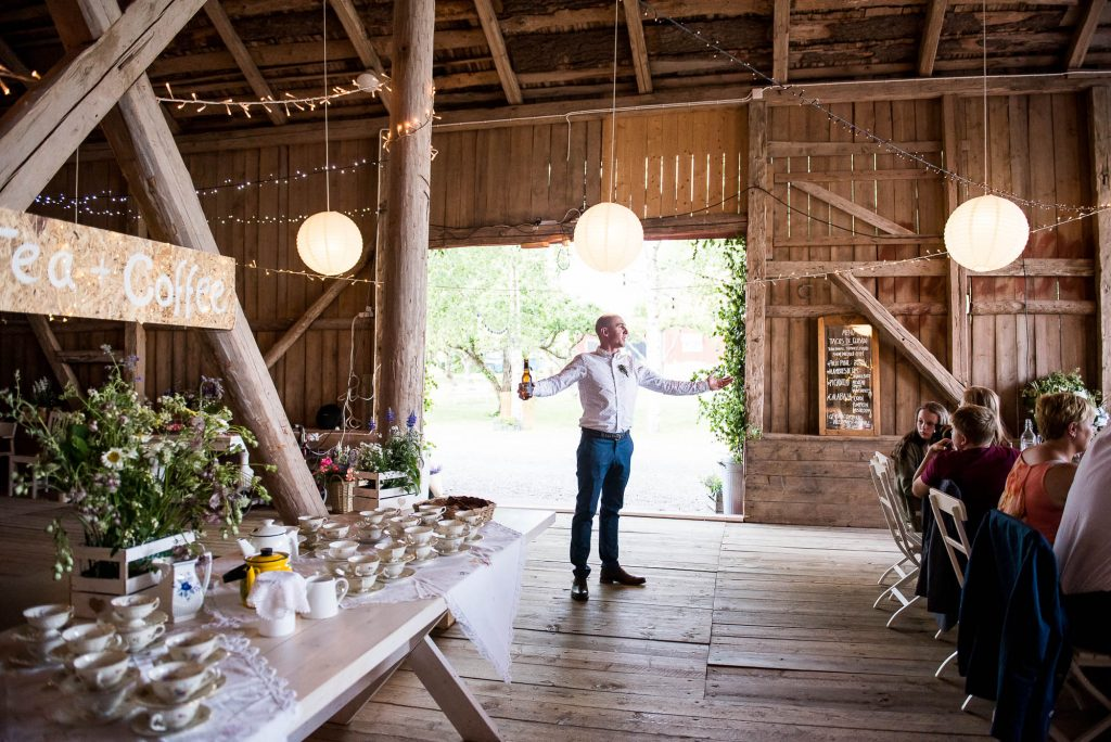 LGBT wedding photography, wedding celebrant announcing the couple as husband and wife into the wedding barn