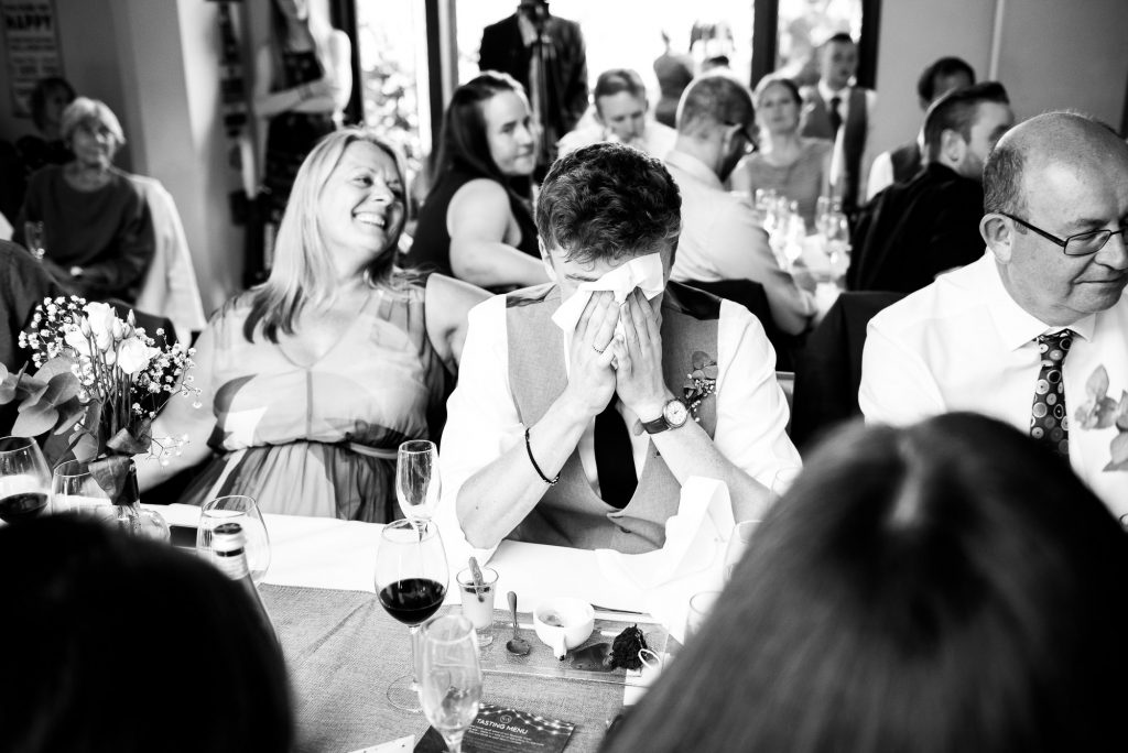 LGBT wedding photography, wedding guests shed a tear during speeches