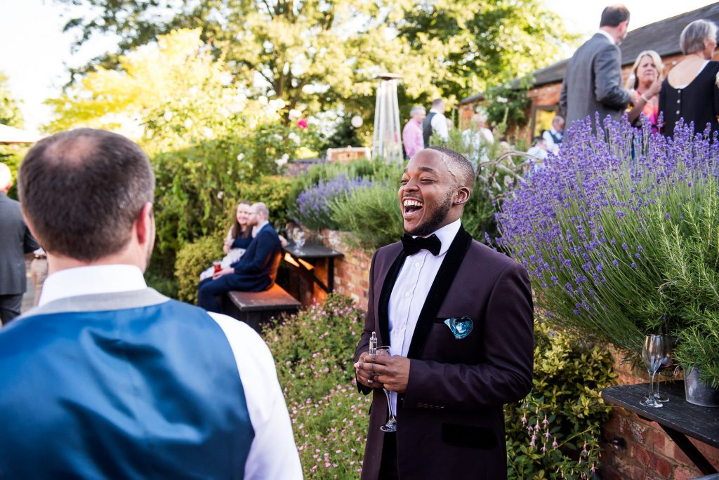 LGBT wedding photography, guests laughing candidly