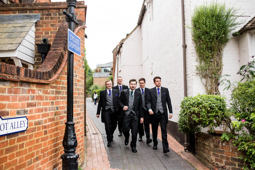 LGBT wedding photography, groomsmen walking to the ceremony together