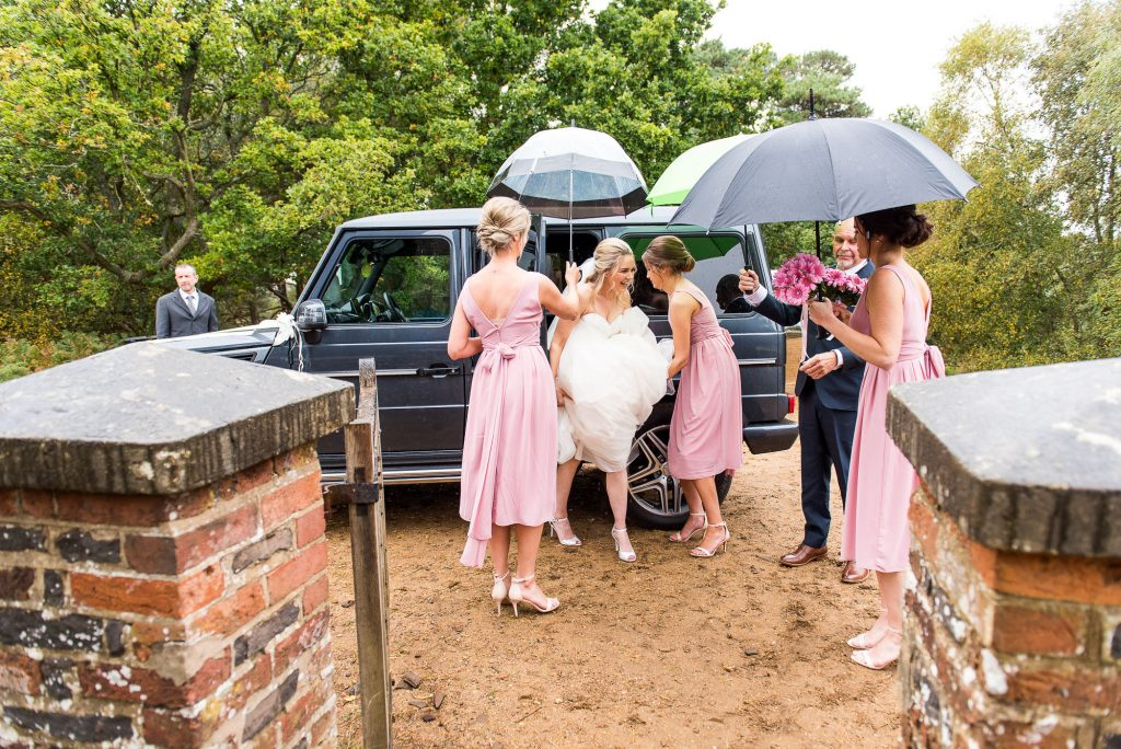 st martha's wedding, bride gets helping hand to the ceremony from her bridesmaids