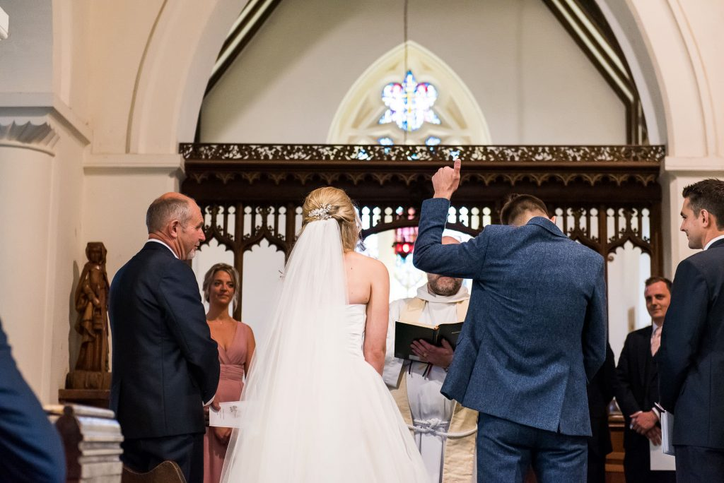 st martha's wedding, groom sticks his thumb up in a comical wedding moment