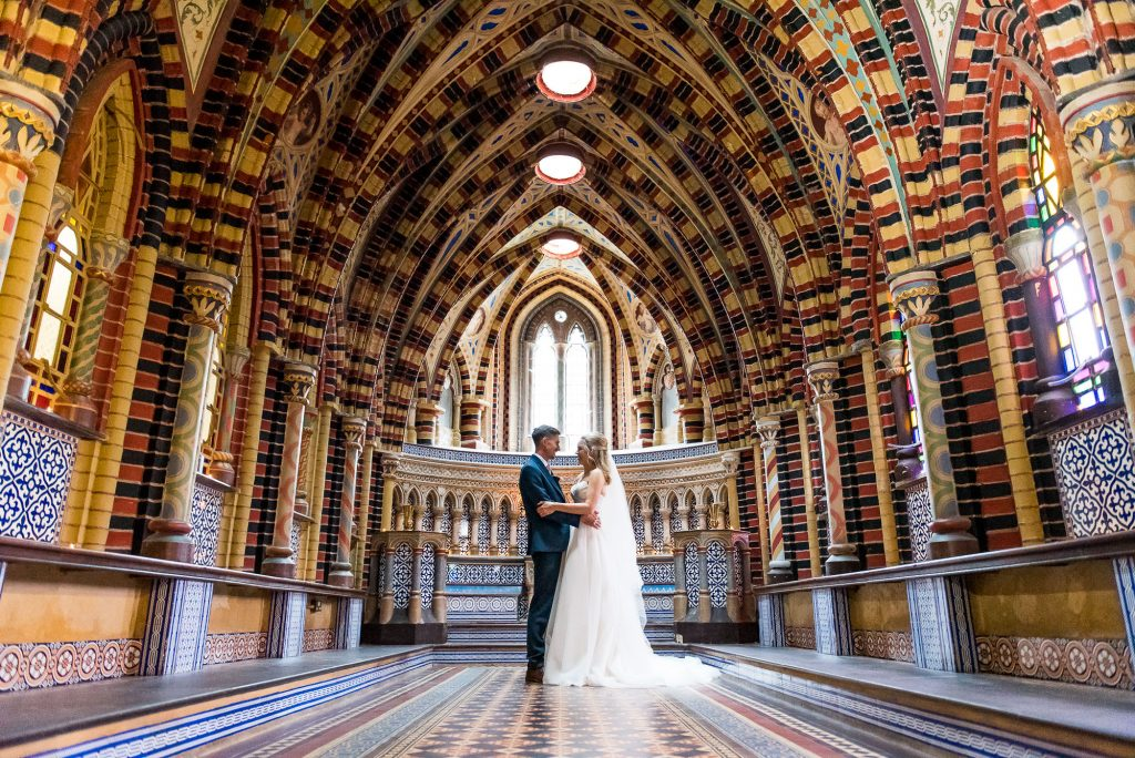 natural wedding photography, couple stand in the chapel at Horsley Towers