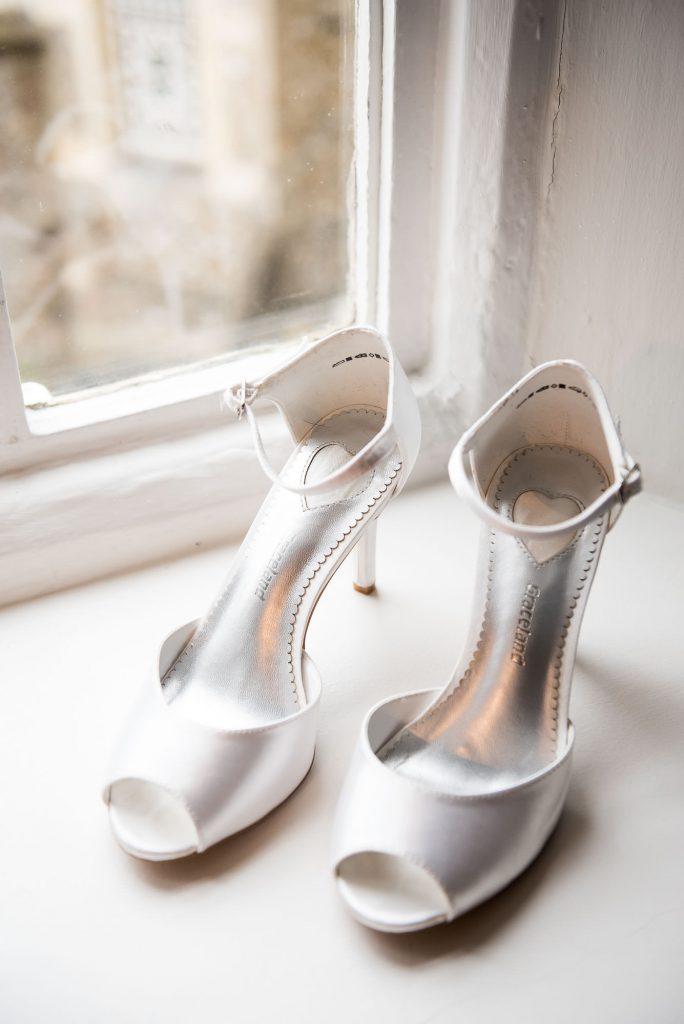 bridal shoes on windowsill