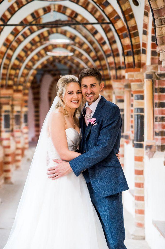 bride and groom smile sweetly