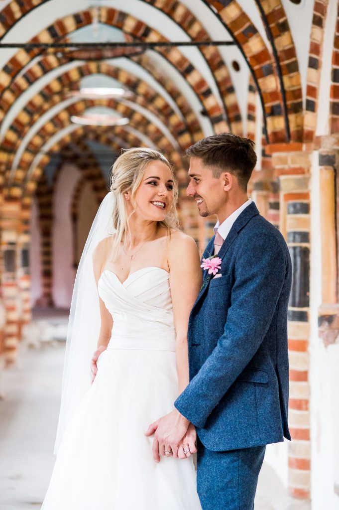 bride and groom look at each other lovingly, natural wedding photography