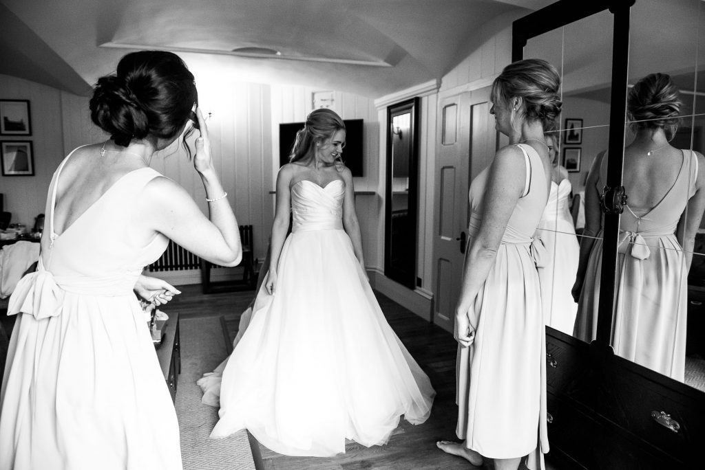 black and white image of bride in her strapless dress