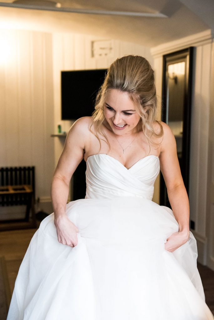 st martha's wedding, gorgeous bride smiling as she gets dressed