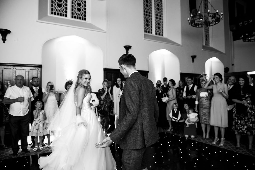 black and white photograph of bride and groom sharing their first dance