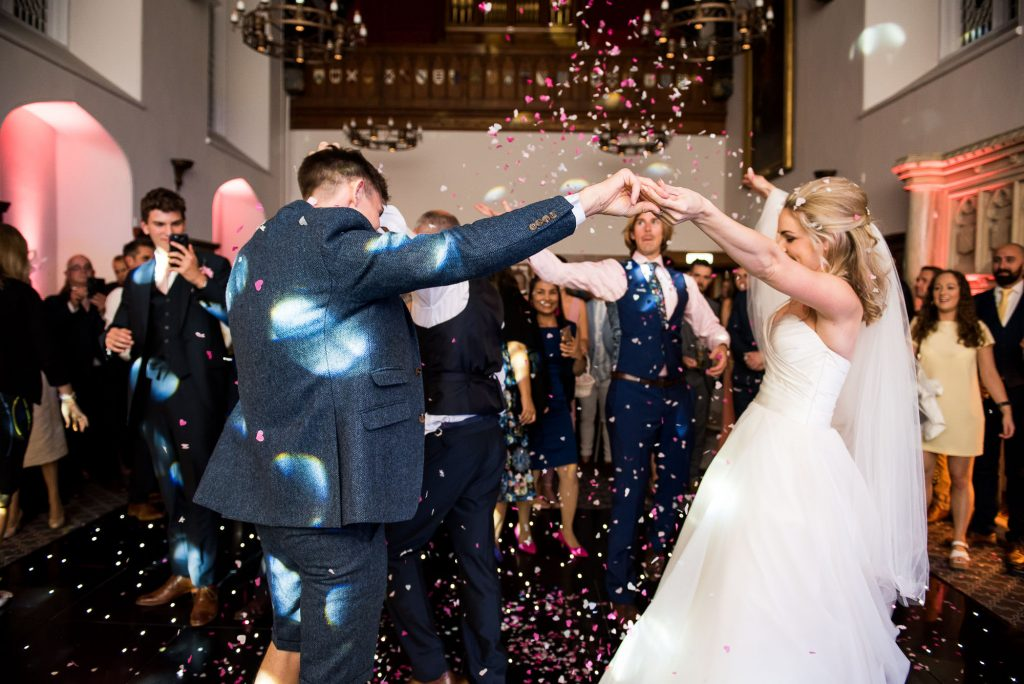 guests throw confetti on the bride and grooms first dance