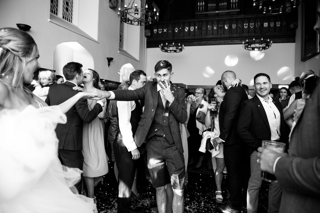 st martha's wedding, groom dressed in suit shorts on the dance floor