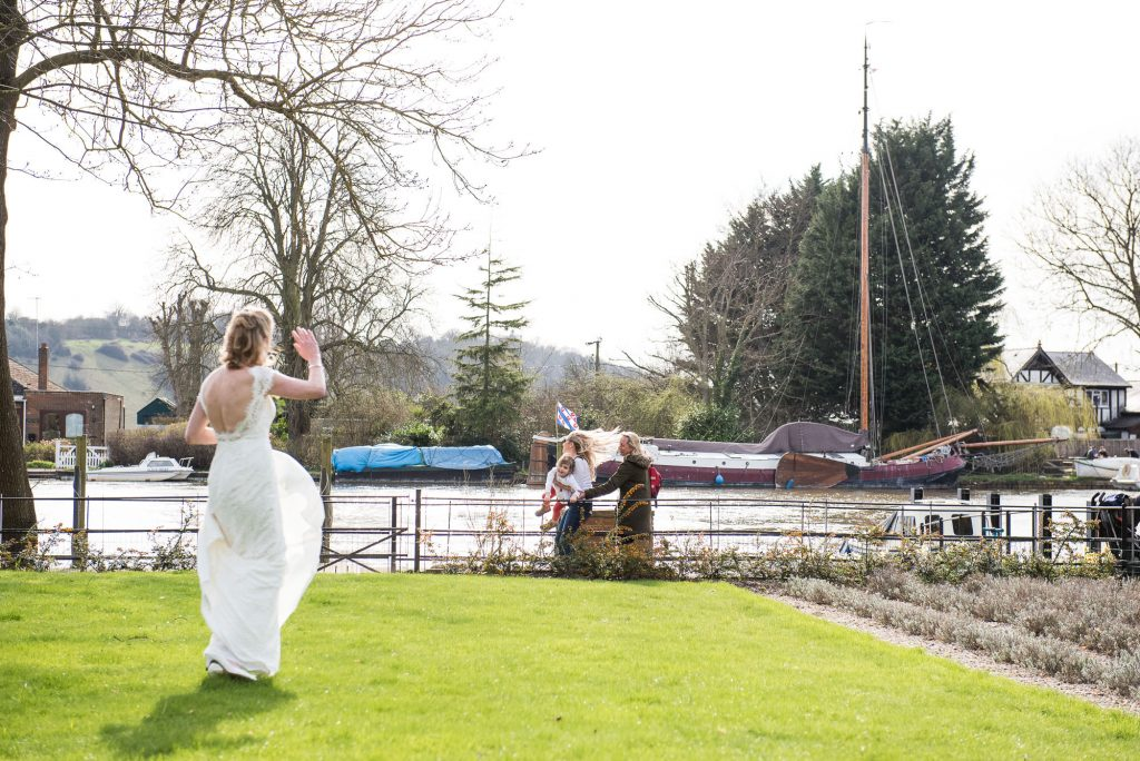 Bride waves at a passer by