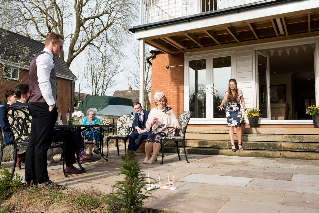 Wedding guests playing garden games