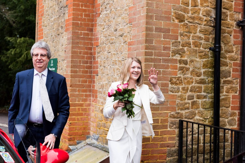 Natural and stylish Scandinavian bride waves at guests