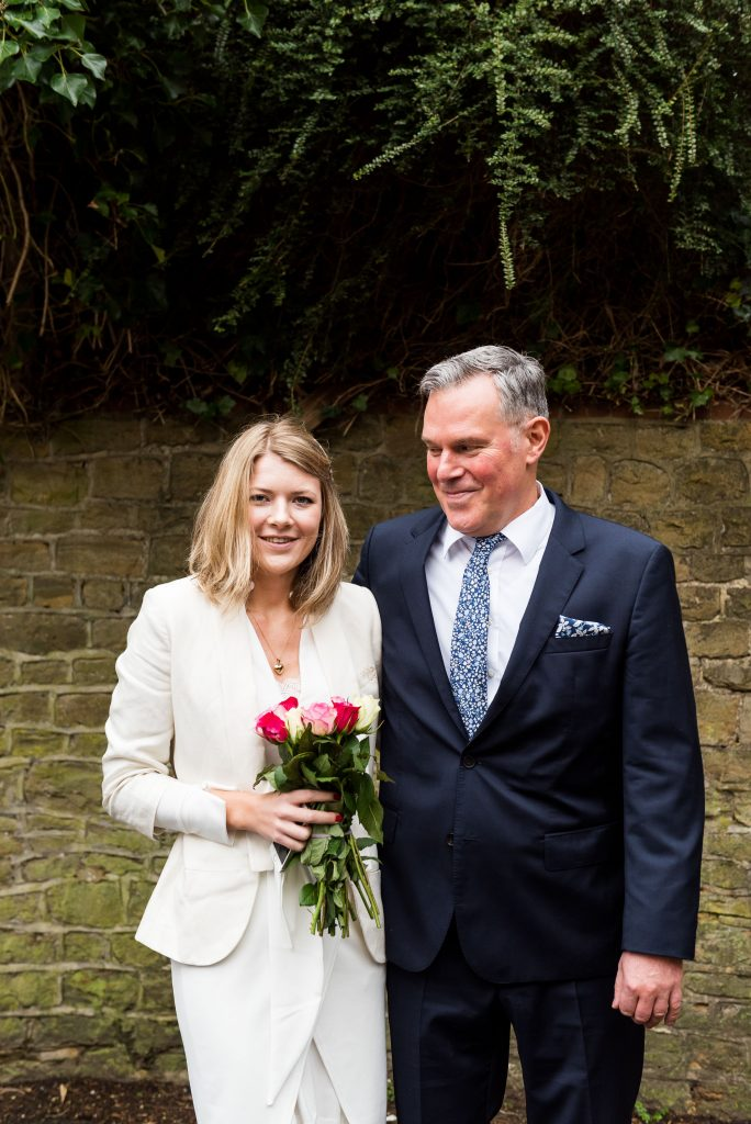 Beautiful Scandinavian bride and her father before the ceremony