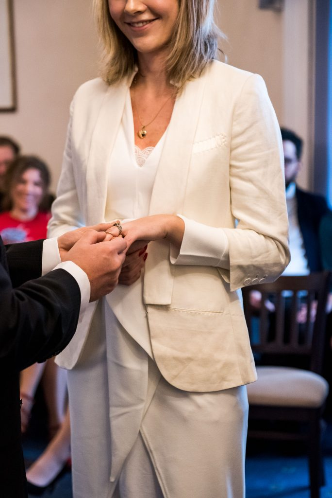 Groom exchanges rings with his bride Artington House Wedding