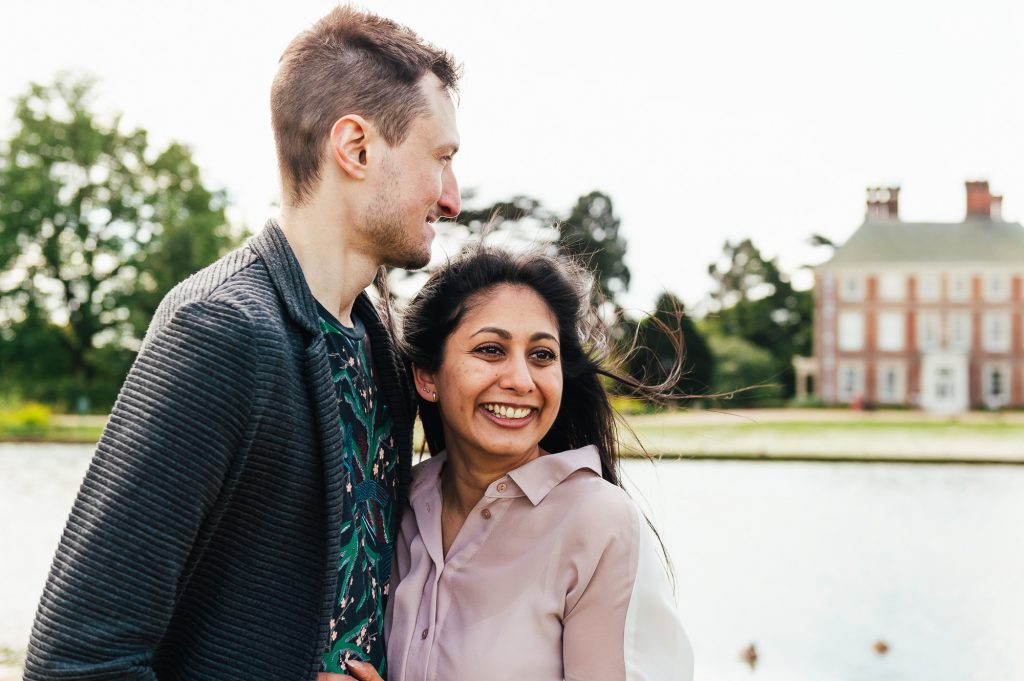 Engaged couple standing in the grounds of Forty Hall, London engagement photography