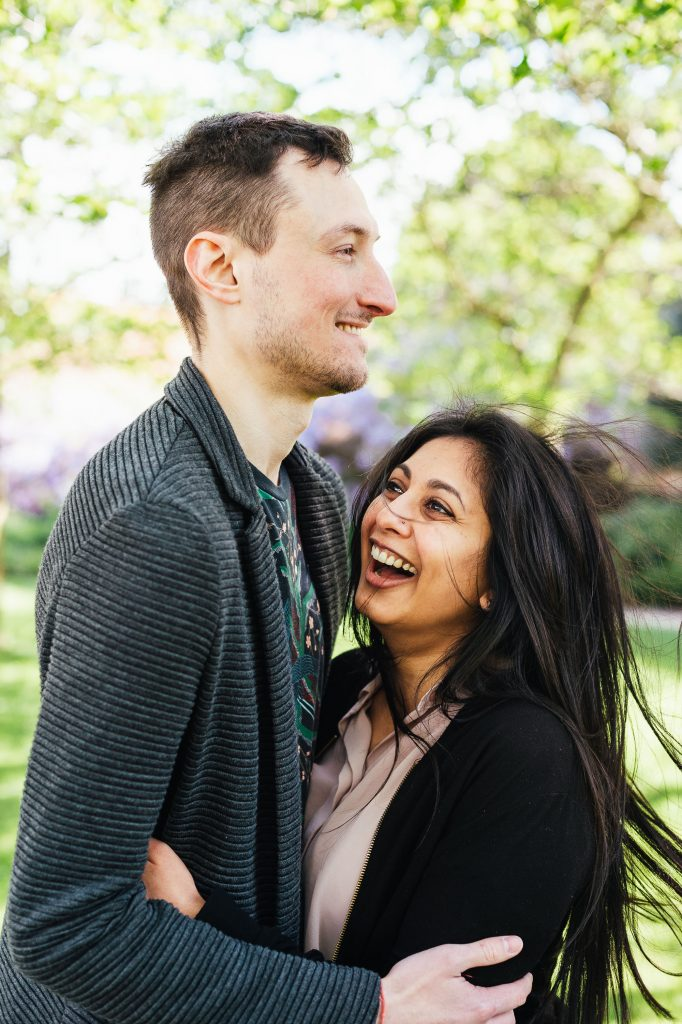 Forty Hall engagement photography - couple smile and stare at each other on London engagement shoot