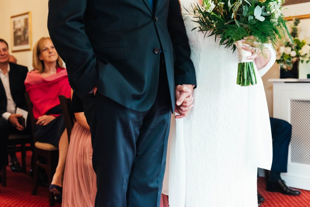 Wedding detail photography, couple holding hands