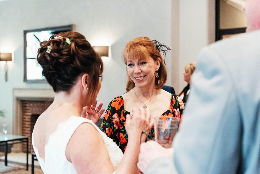 Candid guest reactions at Oatlands Park reception